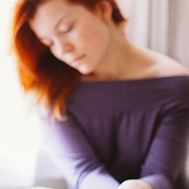 Foto de mulher com ar sereno - Coaching adaptado à tua personalidade